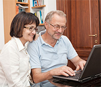 50's couple shopping for life insurance online