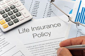 person signing life insurance policy